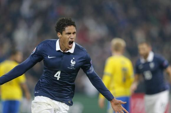 France's Raphael Varane celebrates after scoring against Sweden during their international friendly soccer match at the Velodrome stadium in Marseille, November 18, 2014
